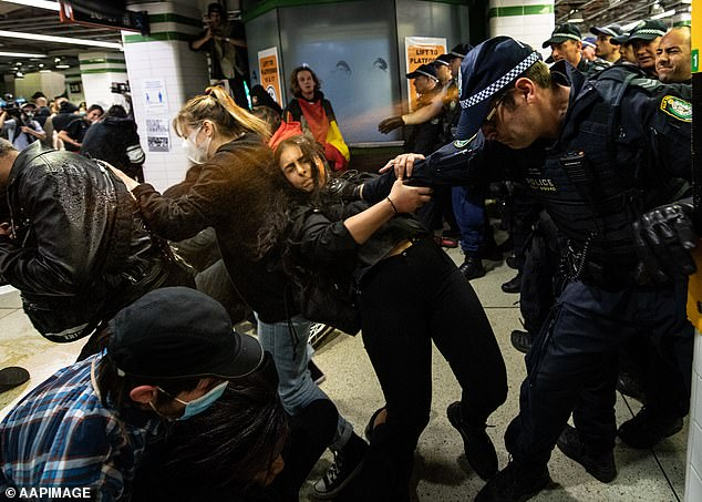 Mr Abbott's criticism of the movement comes ahead of Black Lives Matter protests planned for Sydney next Tuesday. Pictured: Protesters clash with police after a Black Lives Matter rally in Sydney, Saturday, June 6