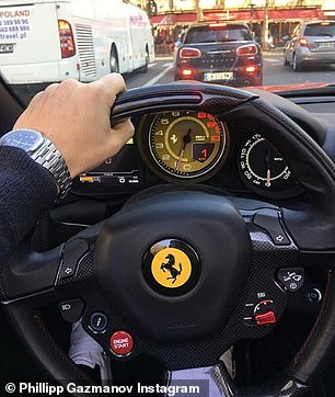 Phillip often shows off his love of private cars, pictured here he shows off an expensive watch while driving a Ferrari