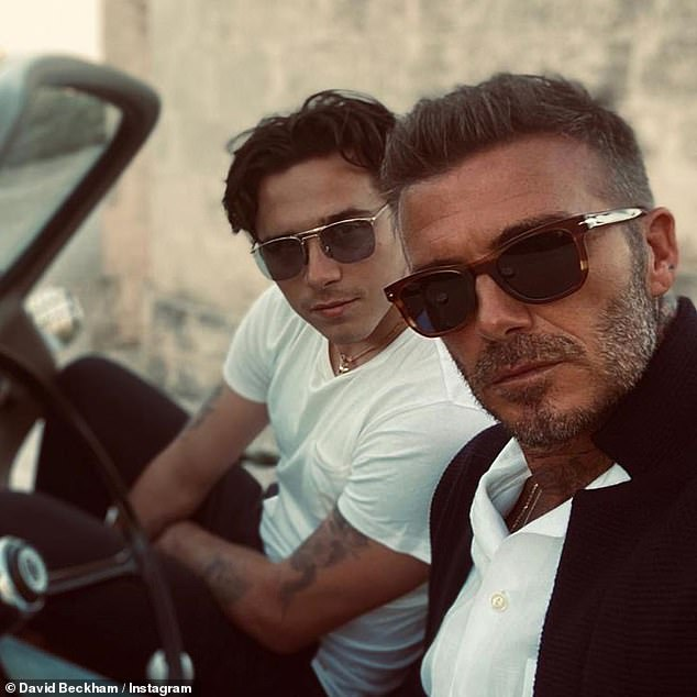 David and Brooklyn Beckham look dapper as they model shades from ...