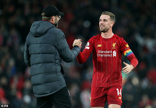 Henderson kisses manager Jurgen Klopp after successful Liverpool campaign