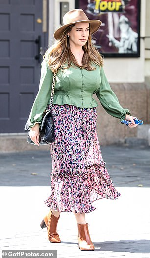 Edgy: She added a flowing floral floor-length skirt