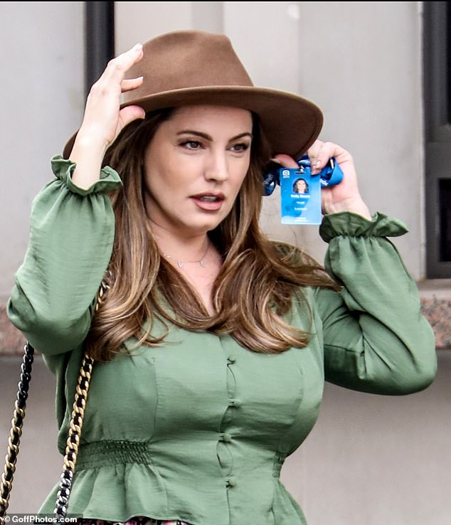 A change: Arriving to host her Heart drive-time radio show in London , the former glamour model, 40, went for a chocolate fedora for Friday's ensemble