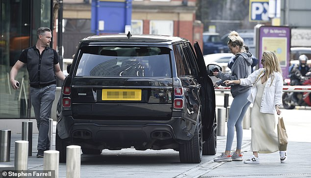 Off they go: Olivia appeared to be in good spirits after collecting her £120K car
