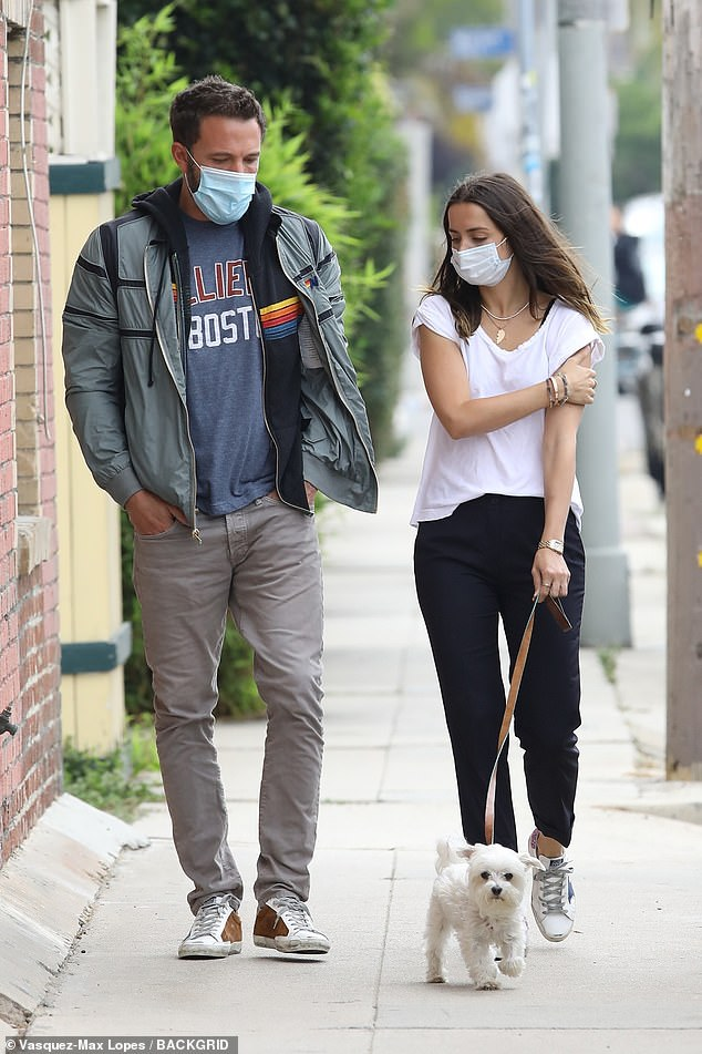 Happy couple: Ben Affleck and Ana De Armas were spotted taking the 32-year-old's dog Elvis for a walk near their home in Venice Beach, California on Friday, where they have been hunkering down during the crisis