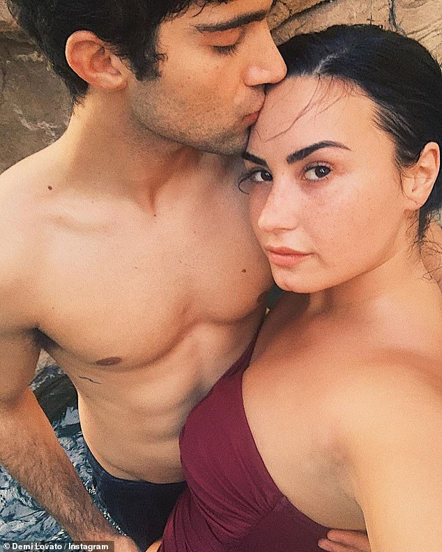 Loved: Demi was elated on Wednesday when she announced her engagement to actor Max Ehrich, with whom she revealed her relationship earlier this year