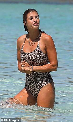 Looking good: Elisabetta added a couple of silver necklaces to her beach day ensemble