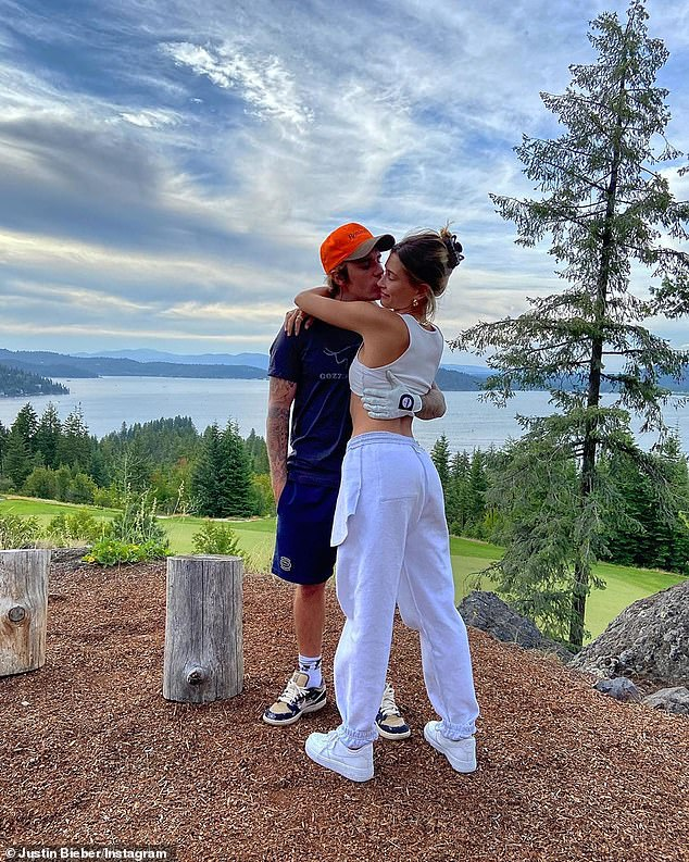 A lot of love: On Friday, the Baby singer uploaded two portraits of himself and Hailey posing with their arms around one another as they took in the breathtaking views.