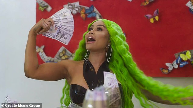Costly fan: Her look again is different, as she dons a lime green wavy wig and a black latex top with a halter top neck