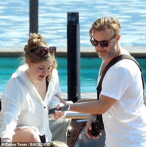 Doting dad: Gary helped Emily also get off the boat safely as he held onto her arm