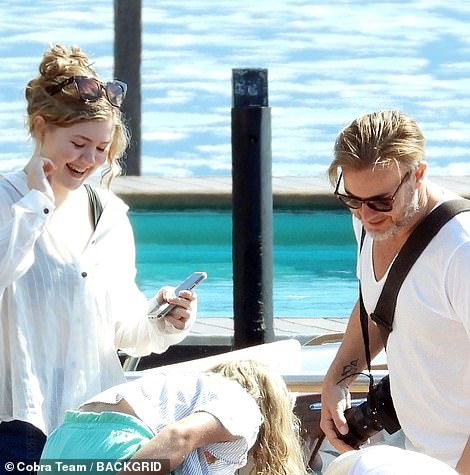 Comfy: Emily wore a loose white shirt over her bikini