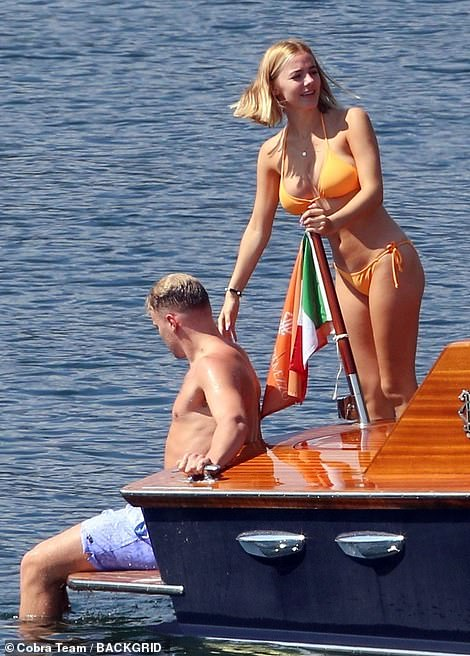 Stylish:Daniel's girlfriend looked sensational in an orange bikini as they chatted together while on the boat before also swimming