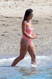 Sam Faiers showcases her figure in a pink swimsuit before packing on the PDA with Paul Knightley