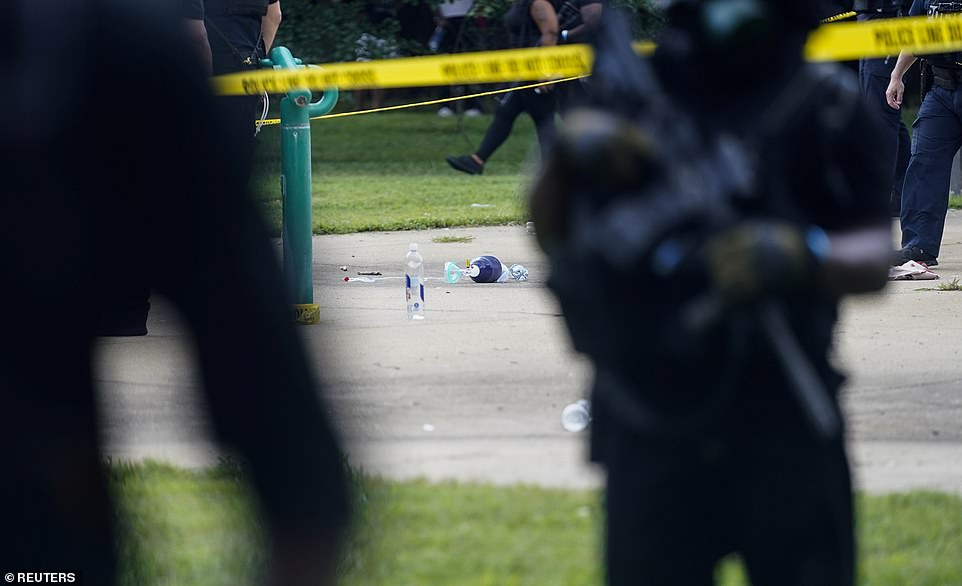 A piece of medical equipment lies on the ground as police officers investigate a shooting in Louisville, Kentucky, on Saturday