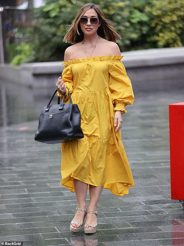 Chic:Myleene Klass, 42, was dressed for the summer in a chic mustard yellow dress as she arrived at Smooth Radio in London on Saturday