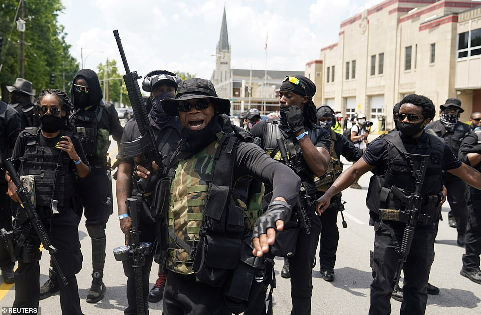 Members of an armed, all-black militia known as NFAC approach City Hall in Louisville, Kentucky, on Saturday
