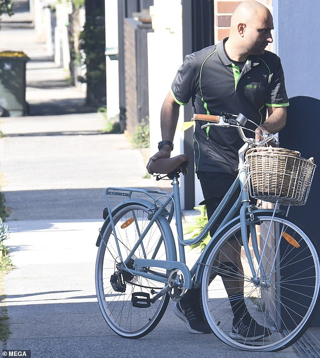 Move it: Other items being lugged out of the home included the star's bike and a surfboard
