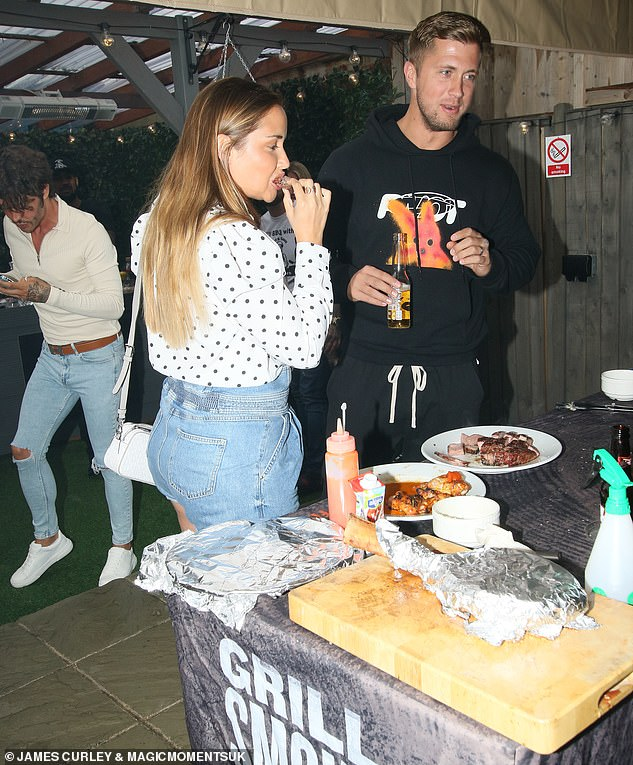 Tucking in: Jacqueline and Dan appeared to be in good spirits as they helped themselves to some food