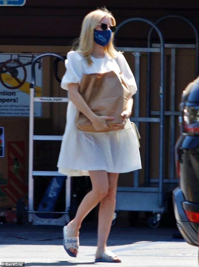 Stylish: The Scream Queens star had her blond hair down for the outing, and she wore cat eye shades along with a blue face mask