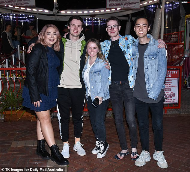 Strike a pose: The Big Brother housemates were later spotted enjoying Sydney's Darling Harbour - posing near the ferris wheel