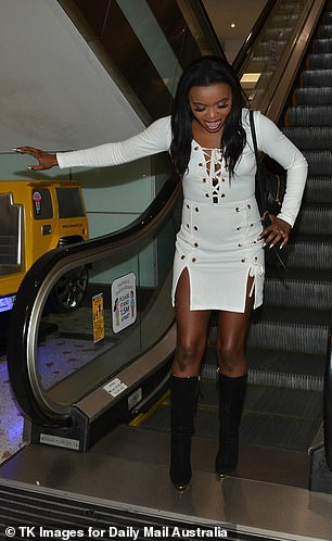 Stylish: Angela, 37, (pictured) looked chic a white dress and knee high boots
