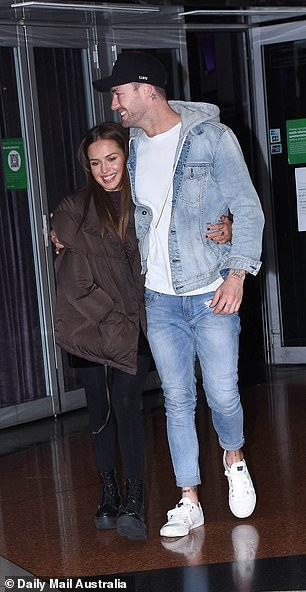 Model off-duty: Chad, 27, rocked a double denim ensemble which consisted of a long-sleeve furry hooded jacket and ripped jeans
