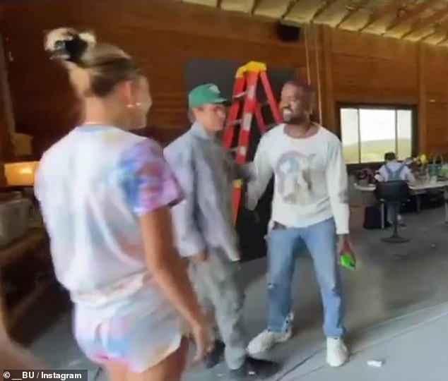 Justin Bieber and wife Hailey greet Kanye West with hugs as they stop by the rapper's Wyoming ranch