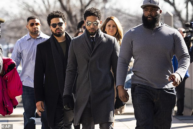 The 38-year-old actor, who is black and gay, was accused of staging a fake attack on himself and claimed his assailants called him racial and homophobic slurs in Chicago in January 2019. Smollett pictured arriving to court in March 2019 in Chicago