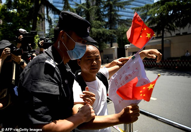 A constant stream of onlookers in the city of 16.5 million flowed past the building over the weekend, many taking photos. As the US consulate closed, crowds of local residents gathered outside, with many waving Chinese flags and taking selfies