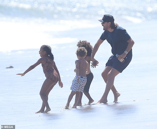 Warning: North let out playful screams once she spotted an impending wave