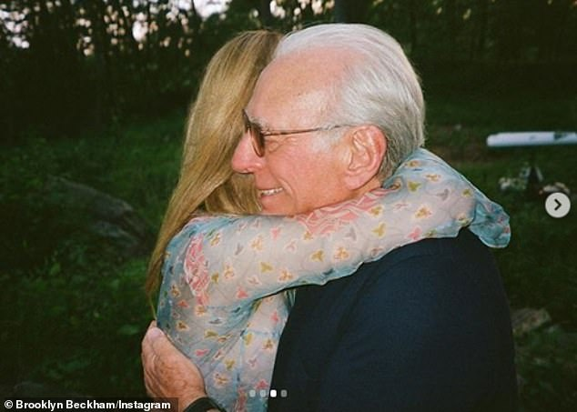 Special: Brooklyn shared the emotional moment Nicola and her billionaire father Nelson, 78, jubilantly hugged in the wake of their engagement
