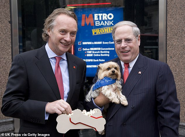 Metro Bank co-founders Anthony Thomson and Vernon Hill at the opening of Metro Bank's first branch in London on July 29, 2010