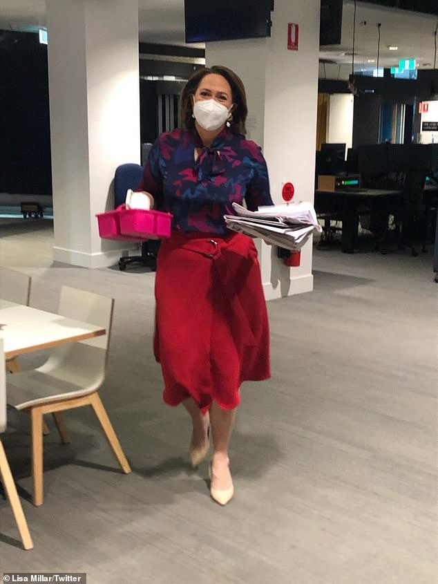 ABC Breakfast presenter Lisa Millar wears a face mask in the office during the COVID-19 pandemic