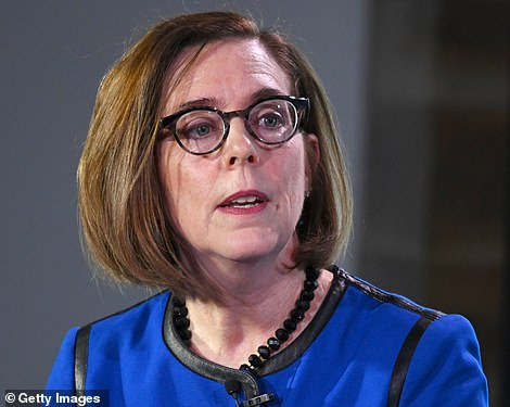 Just before Trump's tweets, Oregon Gov Kate Brown (left) confirmed in a statement that the federal government agreed to withdraw agents from Portland