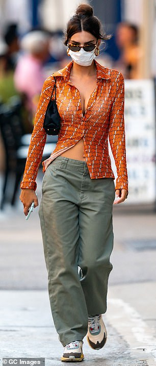 Green with envy: She paired the sexy piece with some army green pants