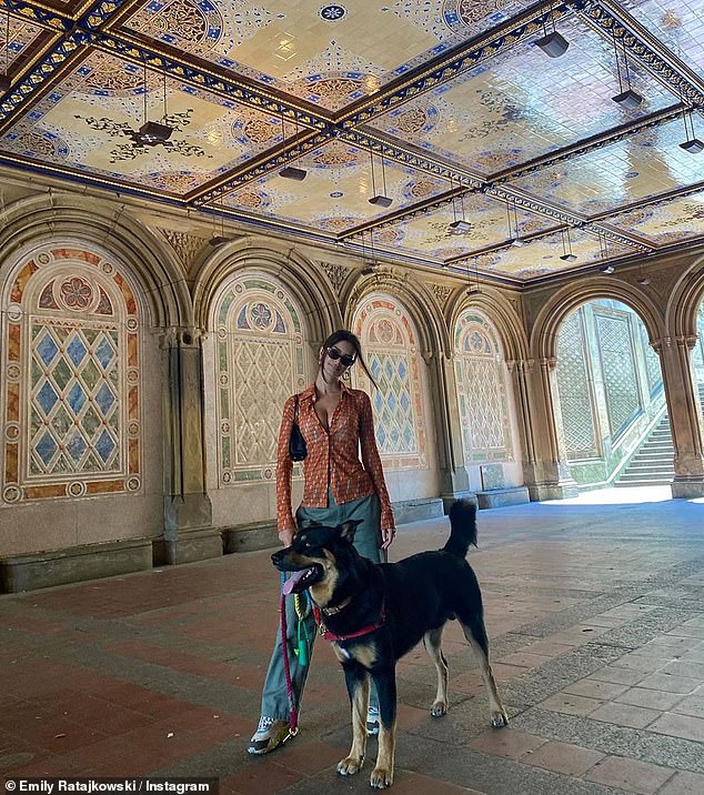 Photo op: She stopped for a photo with her 'baby boy' under the gorgeously ornate Bethesda Terrace, a popular touristy spot