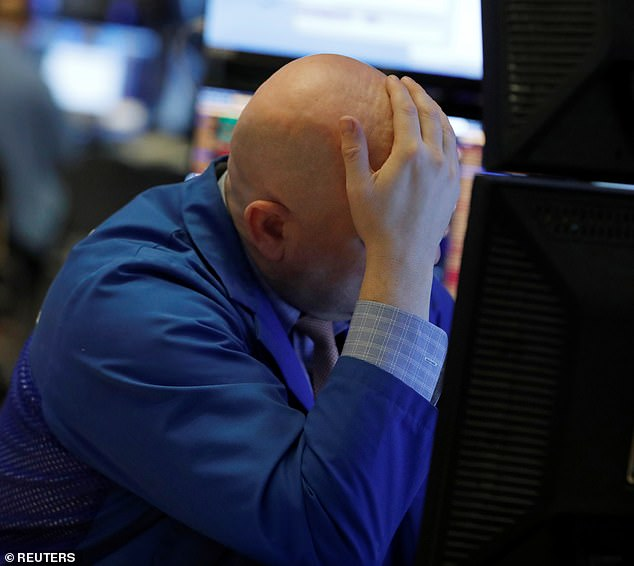 Bad day in the office: A trader on the New York Stock Exchange looks at the devastation