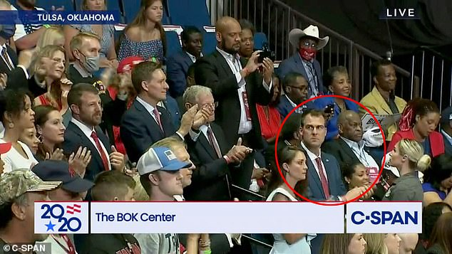 Oklahoma Governor Kevin Stitt sat next to Hermain Cain during the June 20 rally in Tulsa. Stitt announced he tested positive for COVID-19 in mid-July, so he was less likely to have been infected directly from the rally, but Cain's positive test returned nine days later