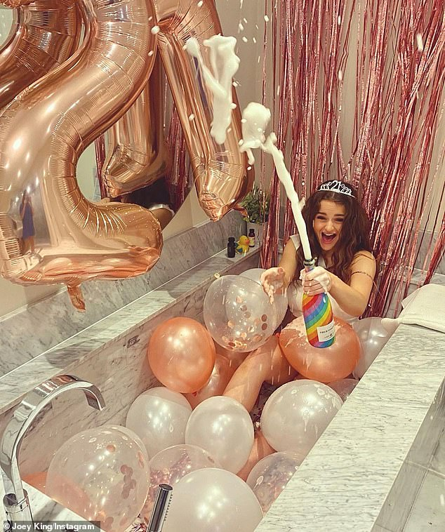 Popping bottles:One of the photos showed the jubilant actress popping the bottle of champagne with large 21 balloons floating above her