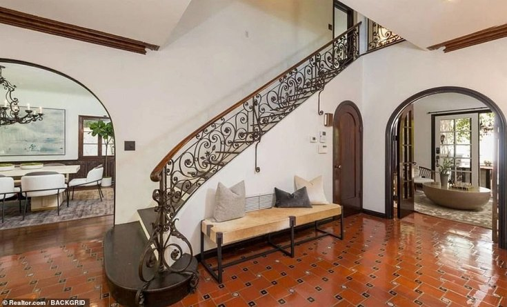Grand staircase: Inside, the main staircase features wrought iron detailing and a wood railing