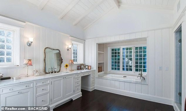 One of the home's large bathrooms is pictured. A listing from the time of the 2018 sale also reveals that the home has a library, a media room and a vegetable patch