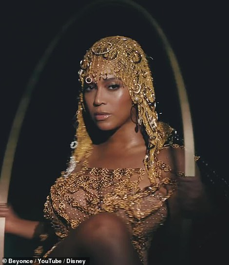 Bey gold: The icon is also seen decked out in all gold, with a shimmering gold dress and a gold headdress as well, as she's seen swinging on a golden hoop swing