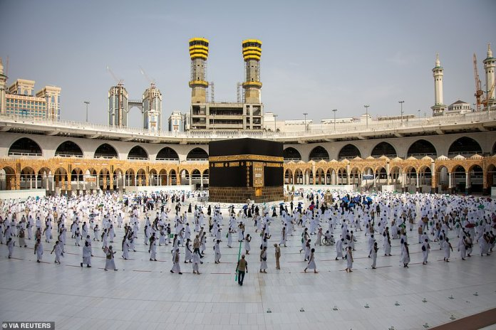 Muslim pilgrims keep their distance by walking around the holy Kaaba while making the Hajj pilgrimage in the Great Mosque of Mecca, which coincides with Eid al-Adha