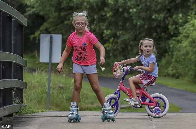 Children are seen playing in Owensboro on Thursday. Of the city's households, 45 percent consist of married couples, and about a quarter had children under the age of 18 at home