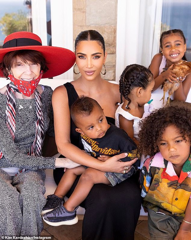 Kim posed alongside her grandmother with her four kids, daughter Chicago, two, son Psalm, one, son Saint, four and daughter North, seven (standing behind)