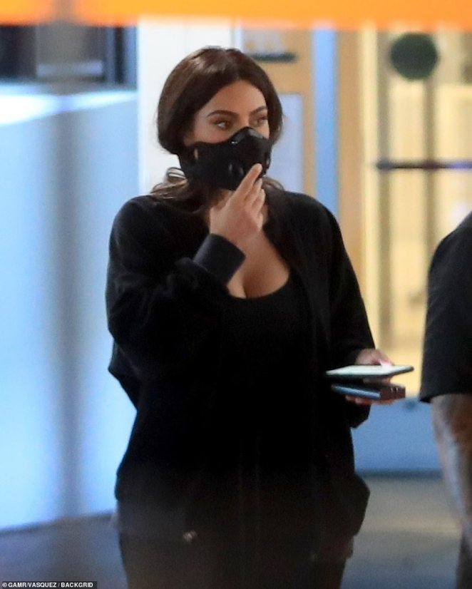 Going solo: Kim Kardashian is pictured out in LA on Thursday leaving an appointment at Cedars-Sinai hospital shortly before embattled husband Kanye West started tweeting again
