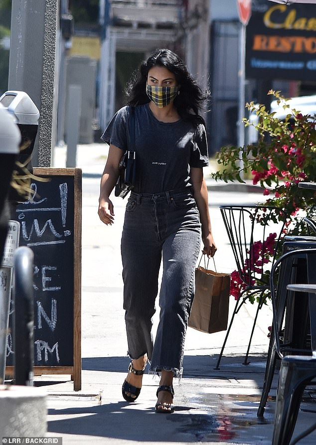 Chic: The 26-year-old actress kept it casual in jeans and a tucked in T-shirt while running errands with her boyfriend in Los Angeles