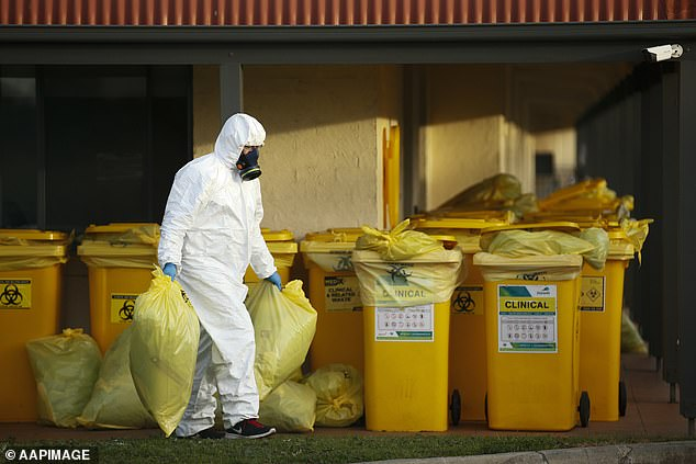Clinical waste disposal staff work at St Basil's Homes for the Aged in Fawkner, Melbourne