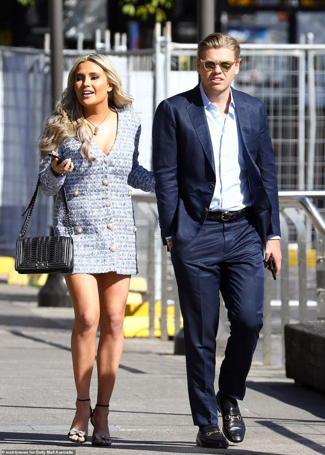 The pair donned a matching blue ensemble and Thrupp hid behind sunglasses and sported a navy blue suit with blue shirt