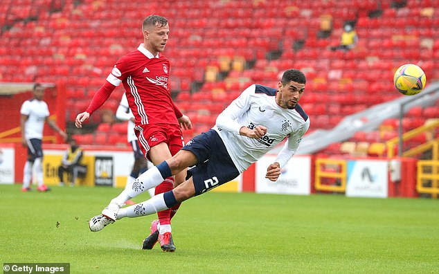 Leon Balogun (right) made his Rangers debut after joining Wigan Athletic this summer