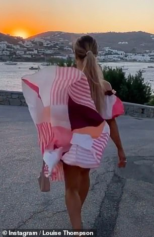 Oops! The beauty strutted along the street, letting her dress get caught in the wind and reveal her peachy posterior